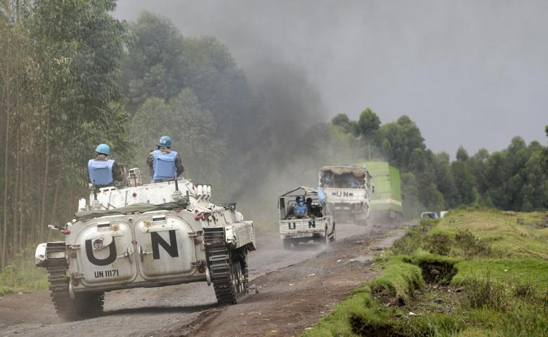 U.N. peacekeepers drive their tank as they patrol past the deserted Kibati village near Goma in the eastern Democratic Republic of Congo, August 7, 2013. REUTERS/Thomas Mukoya