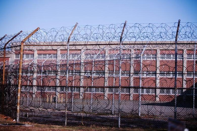 Barbed wire fences surround a building on Rikers Island Correctional Facility in New York December 24, 2013. REUTERS/Lucas Jackson