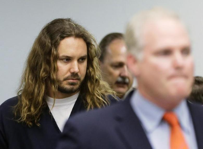 Tim Lambesis, lead singer for the heavy metal band As I Lay Dying, follows his lawyer Anthony Salerno into the courtroom for his arraignment in San Diego North County court in Vista, California, May 9, 2013. REUTERS/Lenny Ignelzi/Pool