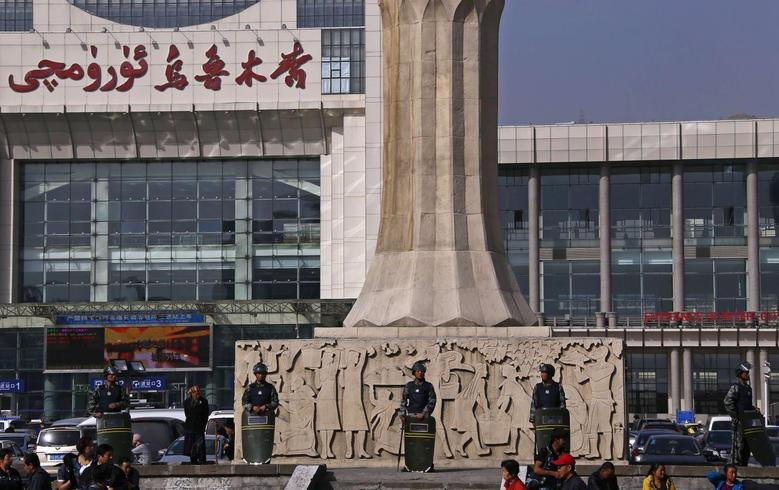 Armed police guard at the entrance of the South Railway Station, where three people were killed and 79 wounded in Wednesday's bomb and knife attack, in Urumqi, Xinjiang Uighur Autonomous region, May 2, 2014. REUTERS/Petar Kujundzic