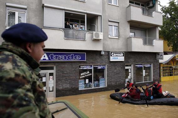 People stand in their apartments as they wait to be evacuated in the flooded town of Obrenovac, southwest of Belgrade, Serbia May 17, 2014. REUTERS-Marko Djurica
