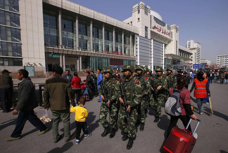 Armed policemen patrol near the exit of the South Railway Station, where three people were killed and 79 wounded in Wednesday's bomb and knife attack, in Urumqi, Xinjiang Uighur Autonomous region, May 2, 2014. REUTERS/Petar Kujundzic