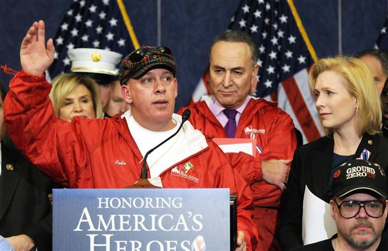Activist John Feal (L) addresses a news conference with U.S. Senator Charles Schumer (D-NY) (2nd R) and Senator Kirsten Gillibrand (D-NY) (R) about their support for a bill to compensate police, firemen and other first responders who are suffering health problems from their work at ground zero after the September 11, 2001 attacks in New York, at the U.S. Capitol in Washington in this file photo from December 21, 2010. REUTERS/Jonathan Ernst/Files