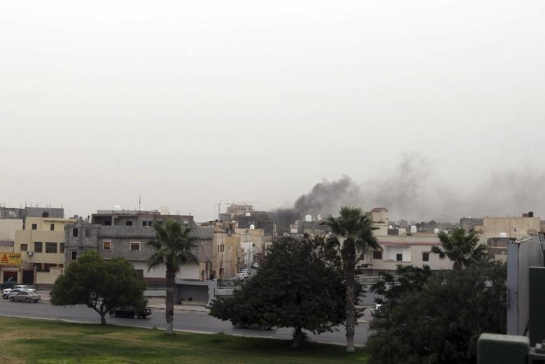 Gunmen loyal to ex-general storm Libyan parliament,...