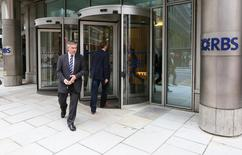 A man leaves an RBS building London May 2, 2014. REUTERS/Paul Hackett