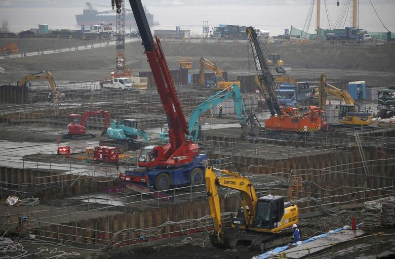 Heavy machinery is seen in a construction site in Tokyo March 13, 2014. REUTERS/Toru Hanai