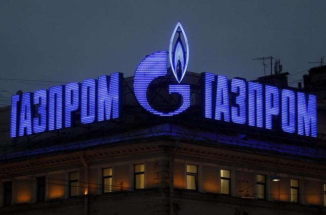 The company logo of Russian natural gas producer Gazprom is seen on an advertisement installed on the roof of a building in St. Petersburg, November 14, 2013. REUTERS/Alexander Demianchuk