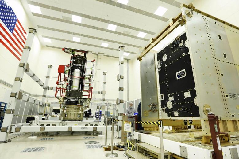 The Propulsion Module (L) and System Module (R) of the first GOES-R series weather satellite are readied for integration and testing at Lockheed Martin's clean room near Denver in this Lockheed Martin handout photo taken April 25, 2014. REUTERS/Lockheed Martin/Handout via Reuters