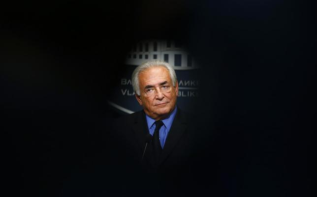 Former International Monetary Fund (IMF) chief Dominique Strauss-Kahn listens to questions during a news conference in the Serbian government building in Belgrade September 17, 2013. REUTERS/Marko Djurica
