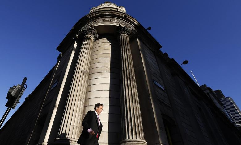 A man walks past the Bank of England in London December 20, 2013. REUTERS/Suzanne Plunkett