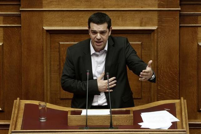 Greece's leader of Radical Left Syriza opposition party Alexis Tsipras addresses parliamentarians in Athens January 17, 2013. REUTERS/Yorgos Karahalis