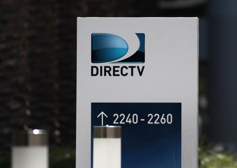 A sign at the headquarters building of U.S. satellite TV operator DirecTV is seen in Los Angeles, California May 18, 2014. REUTERS/Jonathan Alcorn