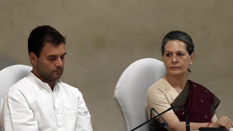Congress party chief Sonia Gandhi (R) and her son and vice-president of Congress Rahul Gandhi attend the Congress Working Committee (CWC) meeting in New Delhi May 19, 2014. REUTERS/Adnan Abidi