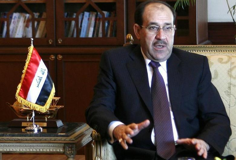 Iraq's Prime Minister Nouri Maliki gestures during talks with his Egyptian counterpart Ahmed Nazif in Cairo December 20, 2009. REUTERS/Asmaa Waguih