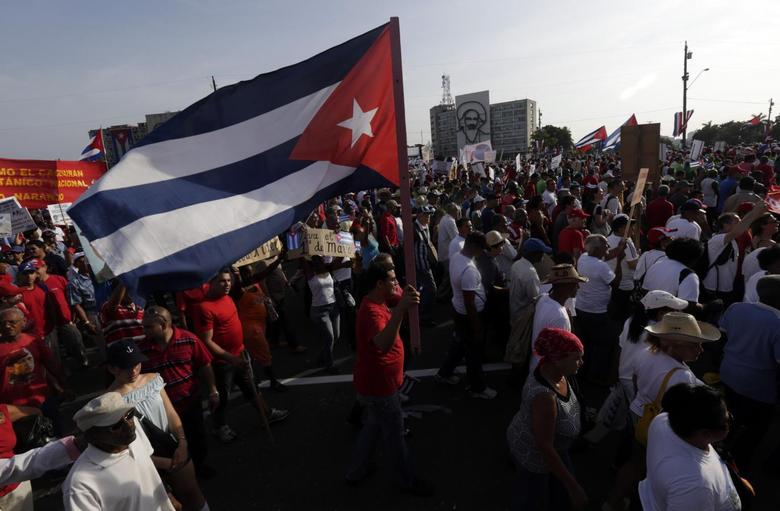 A man waves a Cuban flag in Havana's Revolution Square during the May Day parade May 1, 2014. REUTERS/Enrique De La Osa