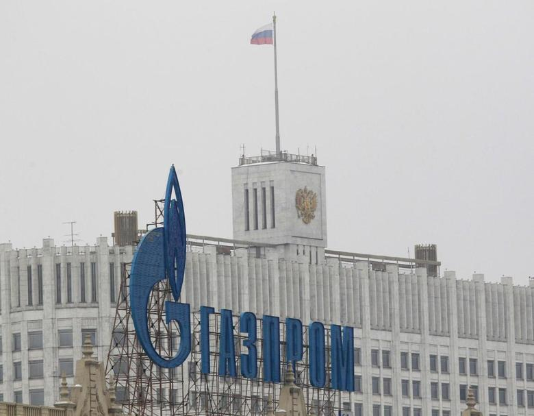 The company logo of Russian natural gas producer Gazprom is seen on an advertisement in front of the White House in Moscow in this February 8, 2013 file photo. REUTERS/Maxim Shemetov/Files