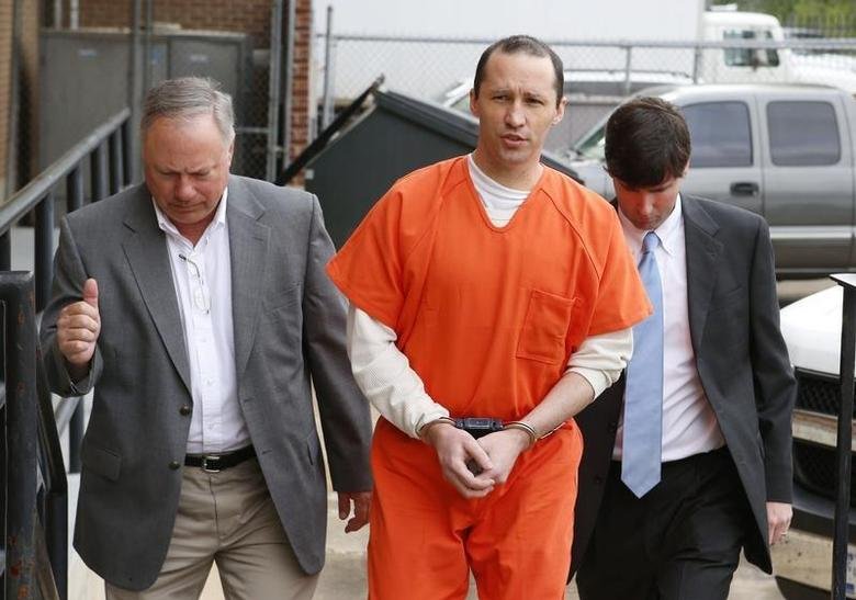 James Everett Dutschke, flanked by U.S. Marshals, arrives for a sentencing hearing at the United State Federal Building in Aberdeen, Mississippi May 13, 2014. REUTERS/Thomas Wells