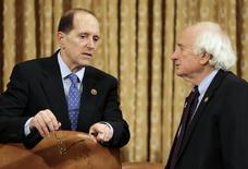 House Ways and Means Committee chair Rep. Dave Camp (R-MI) (L) confers with ranking member Rep. Sander Levin (D-MI) before their hearing on President Barack Obama's FY2015 Budget Proposal in Washington March 6, 2014. REUTERS/Gary Cameron