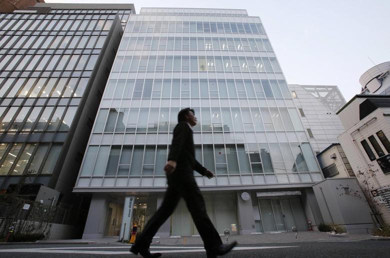 A man walks past a building where Mt. Gox, a digital marketplace operator, is housed in Tokyo February 25, 2014. REUTERS/Toru Hanai