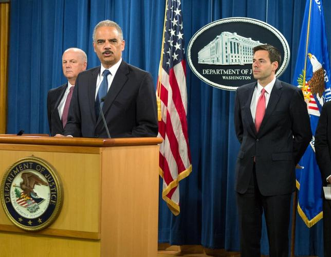 U.S. Attorney General Eric Holder (2nd L) announces the indictments of five Chinese nationals on cyber espionage charges for allegedly stealing trade secrets from American companies, during a news conference at the Justice Department in Washington May 19, 2014. REUTERS/Keith Lane