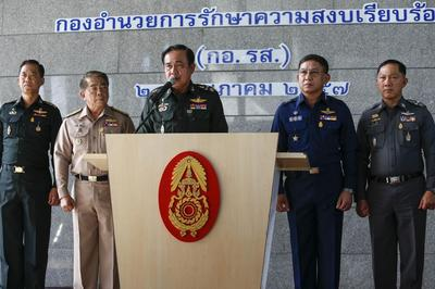 Thai army chief urges rivals to talk after declaring...
