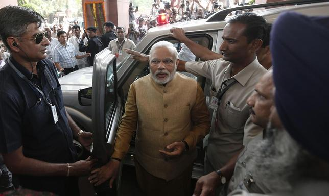 Hindu nationalist Narendra Modi, the prime ministerial candidate for India's Bharatiya Janata Party (BJP), arrives to attend the BJP parliamentary party meeting at parliament house in New Delhi May 20, 2014. REUTERS/Adnan Abidi