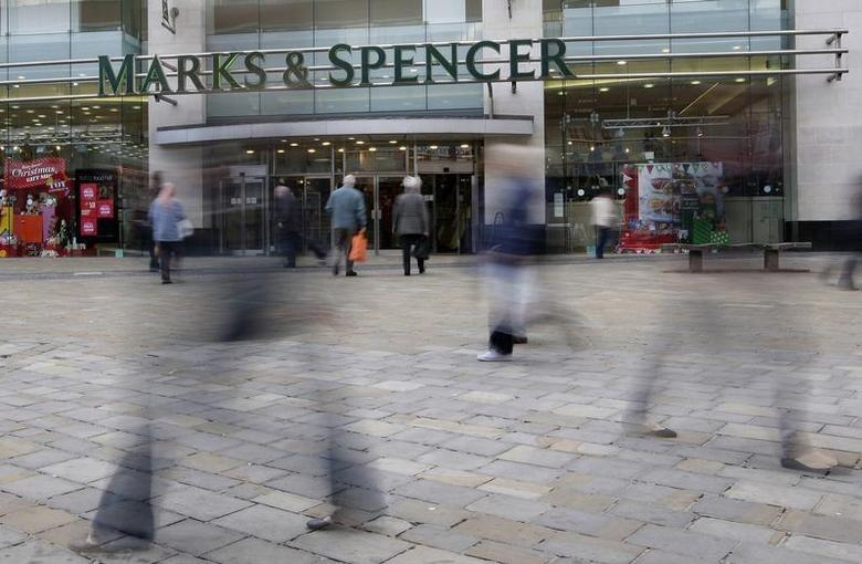 People walk past a Marks and Spencer store in Leicester, central England, November 4, 2009. REUTERS/Darren Staples