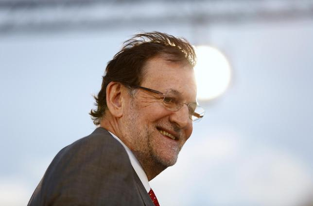 Spanish Prime Minister Mariano Rajoy smiles during an electoral meeting in the Andalusian capital of Seville May 19, 2014. REUTERS/Marcelo del Pozo