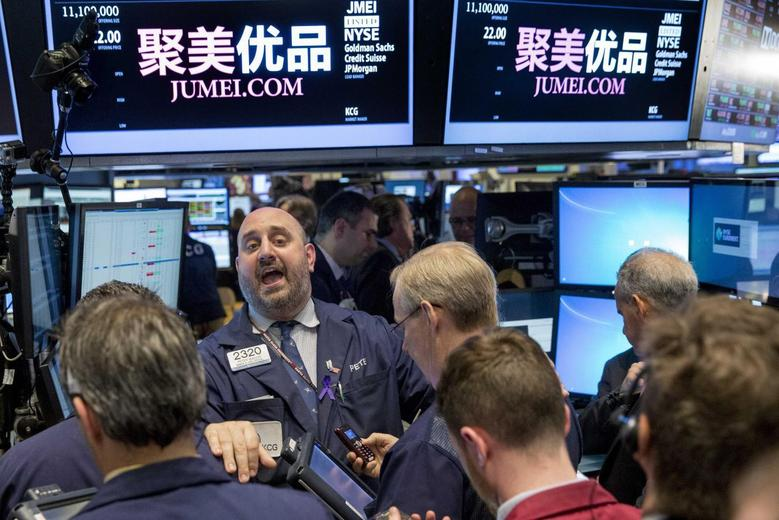 Specialist Peter Giacchi (C) shouts a trading price for Jumei during the company's IPO on the floor of the New York Stock Exchange May 16, 2014. REUTERS/Brendan McDermid