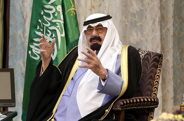 Saudi Arabia's King Abdullah talks during a meeting with U.S. President Barack Obama at Rawdat al-Khraim (Desert Camp) near Riyadh, March 28, 2014. REUTERS/Kevin Lamarque