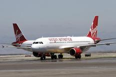 The first Virgin America flights land in San Francisco, California, August 8, 2007. REUTERS/John Decker Virgin America/Pool