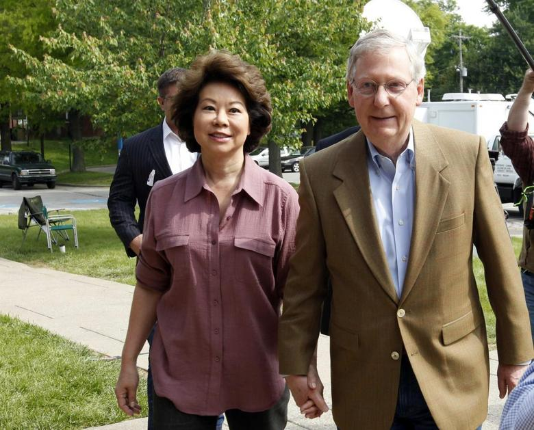 Senate Republican Leader Sen. Mitch McConnell (R-KY) and his wife Elaine Chao arrive at Bellarmine University to cast their ballots during Kentucky's primary elections in Louisville, Kentucky, May 20, 2014. REUTERS/John Sommers II