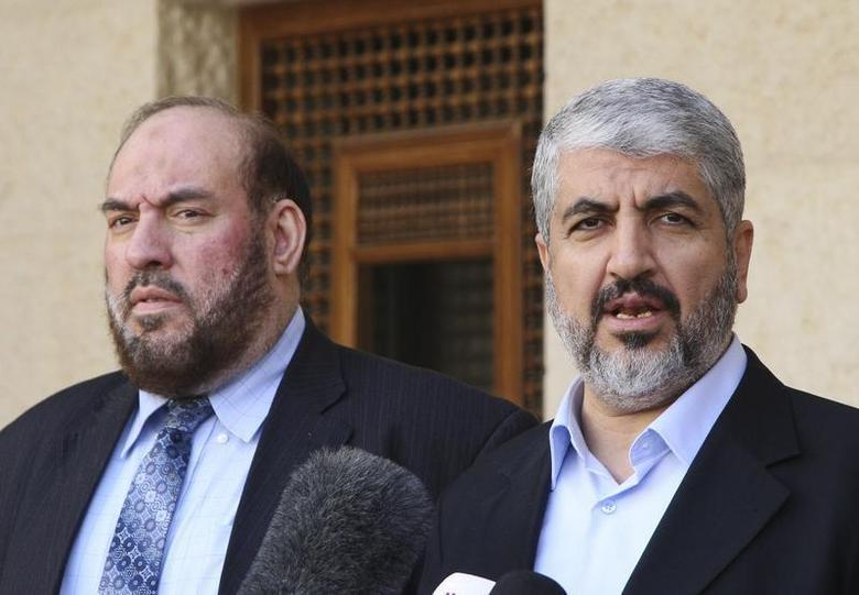 Hamas leader Khaled Meshaal (R) and Mohammad Nazzal, a member of the Hamas leadership, speak to media after their meeting with Jordan's King Abdullah at the Royal Palace in Amman January 28, 2013. REUTERS/Majed Jaber
