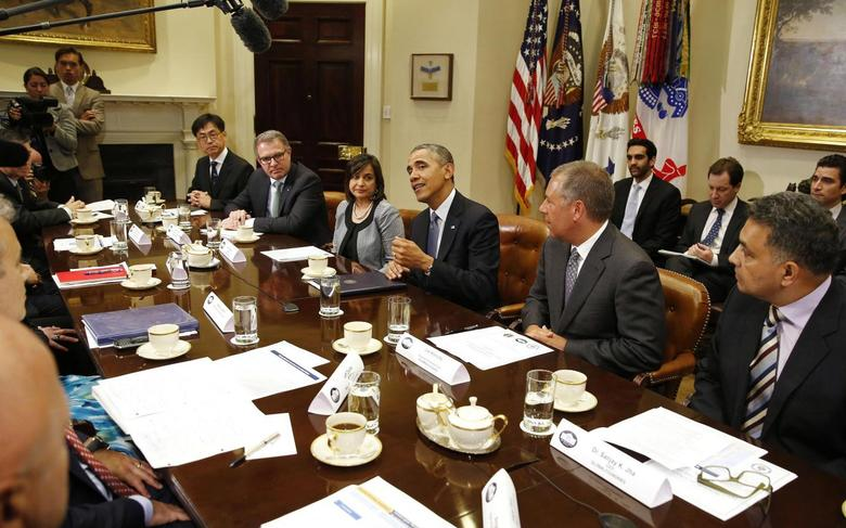 U.S. President Barack Obama (C) talks to international business leaders at a meeting in the Roosevelt Room of the White House in Washington May 20, 2014. Seated from L-R are: Senior Vice President of Hankook Tire Byeong Jin Lee, CEO of Lufthansa AG Carsten Spohr, President of Umicore USA Ravila Gupta, Obama, Executive Vice President of Ford Motor Company Joe Hinrichs, and CEO of GlobalFoundries Sanjay Jha. REUTERS/Larry Downing