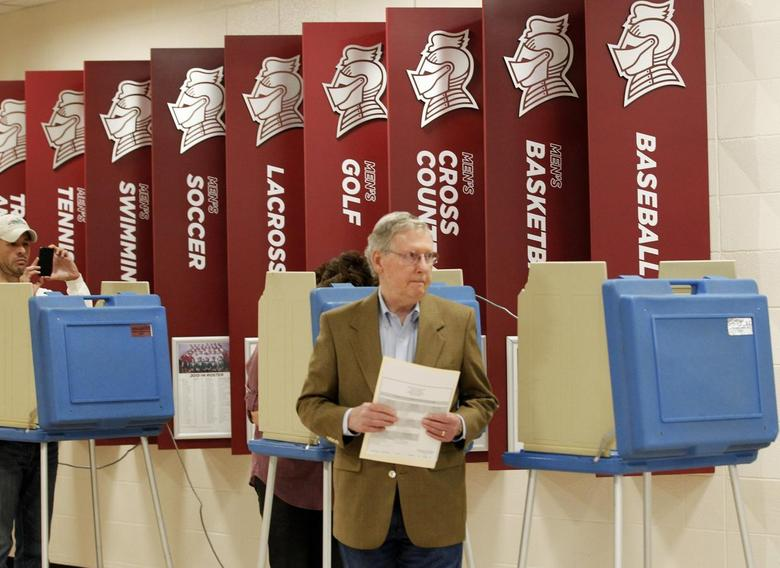 U.S. Senate Republican Leader Sen. Mitch McConnell (R-KY) and his wife Elaine Chao cast their ballots during Kentucky's primary elections at Bellarmine University in Louisville, Kentucky, May 20, 2014. REUTERS/John Sommers II
