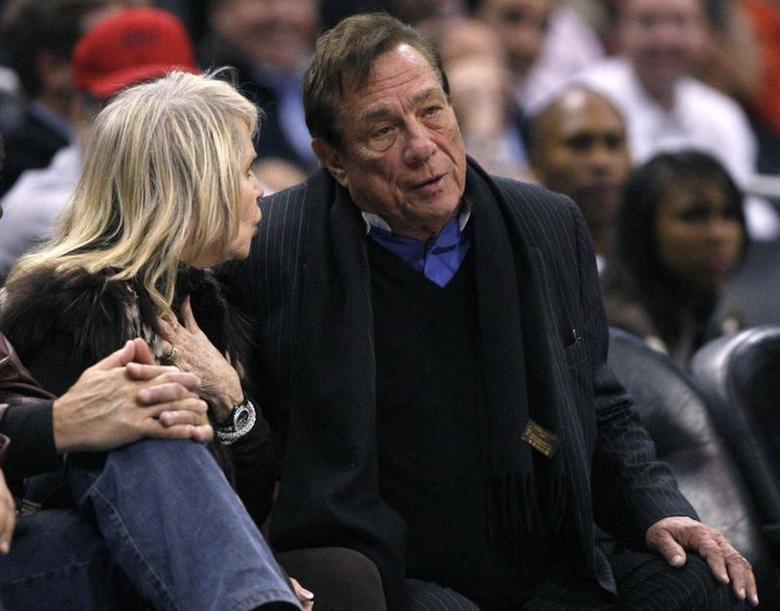 Los Angeles Clippers owner Donald Sterling (R) sits with an unidentified companion as he watches the team play New York Knicks in their NBA basketball game in Los Angeles February 11, 2009. REUTERS/Lucy Nicholson
