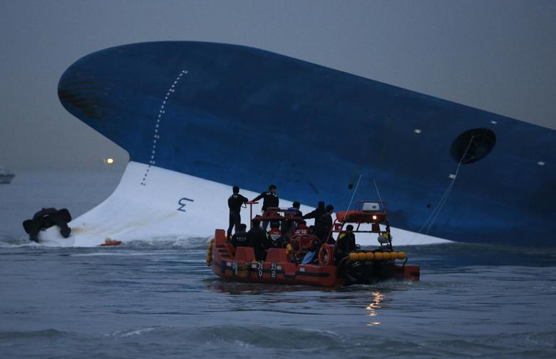 Maritime police search for missing passengers in front of the South Korean ferry ''Sewol'' which sank at the sea off Jindo in this April 16, 2014 file photo. REUTERS/Kim Hong-Ji (