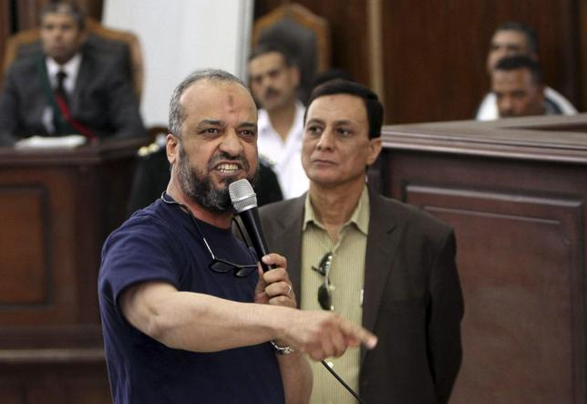 Member of the Muslim Brotherhood Mohamed Beltagy (L) speaks during his trial at a court in Cairo, May 18, 2014. An Egyptian court jailed more than 160 Muslim Brotherhood supporters to up to 15 years in prison on Sunday, pressing a crackdown on the Islamist group before a presidential election former army chief Abdel Fattah al-Sisi is expected to win. REUTERS/Al Youm Al Saabi Newspaper