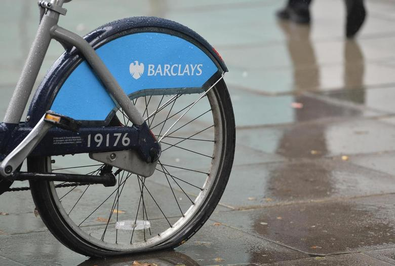 A man walks past a rental bicycle sponsored by Barclays in London July 30, 2013. REUTERS/Toby Melville