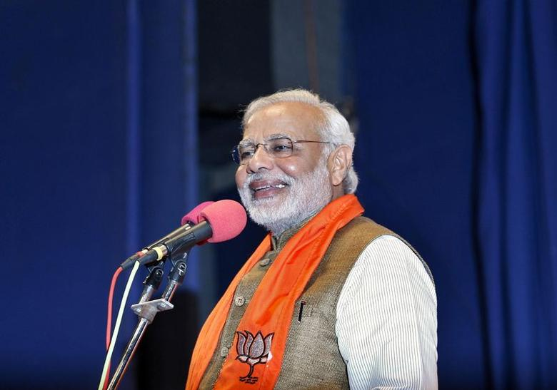 Hindu nationalist Narendra Modi, who will be the next prime minister of India, smiles as he addresses Gujarat lawmakers and party workers during the appointment of the state's new chief minister in Gandhinagar May 21, 2014.REUTERS/Amit Dave