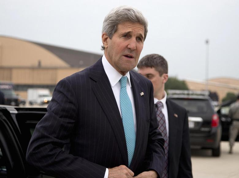 U.S. Secretary of State John Kerry arrives to board his plane en route to Mexico, at Andrews Air Force Base in Maryland May 21, 2014. REUTERS/Carolyn Kaster/Pool