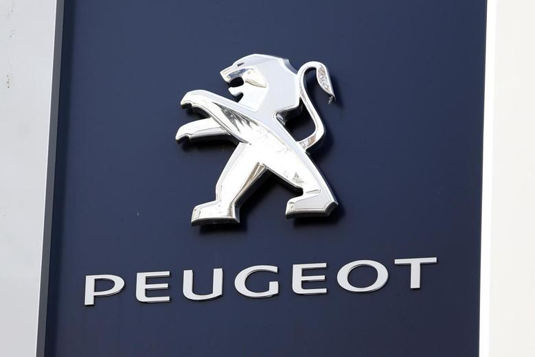 A Peugeot company logo is seen outside an automobile dealership in Paris December 13, 2013. REUTERS/Charles Platiau