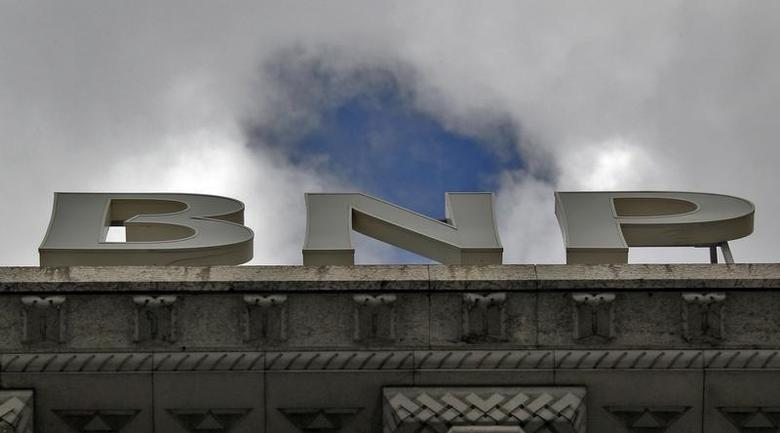 A part of the logo of the BNP Paribas bank is seen on the rooftop of their Paris headquarters April 26, 2012. REUTERS/Mal Langsdon