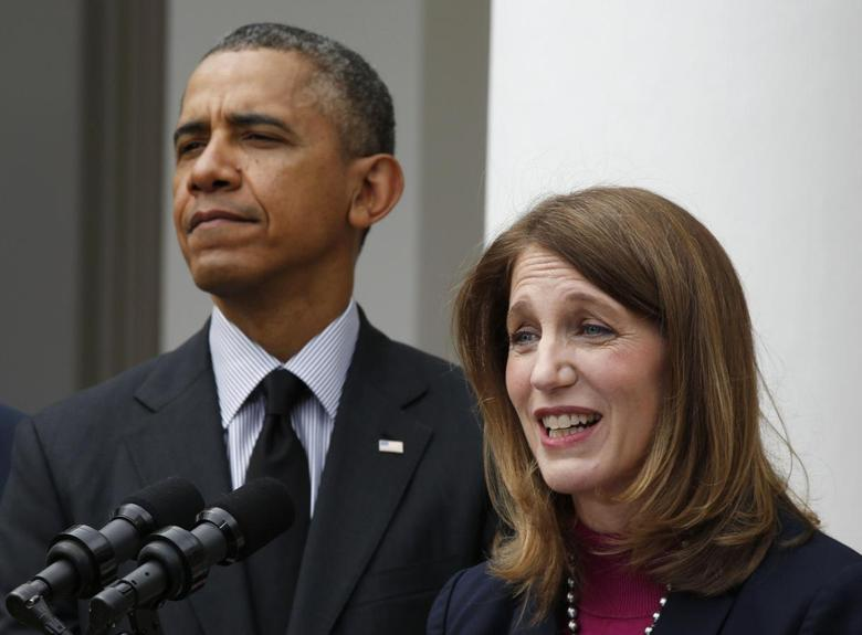 U.S. President Barack Obama listens after nominating Director of the Office of Management and Budget Sylvia Mathews Burwell (R) to replace outgoing U.S. Secretary of Health and Human Services Kathleen Sebelius (not seen), during a ceremony in the Rose Garden of the White House in Washington, April 11, 2014. REUTERS/Larry Downing