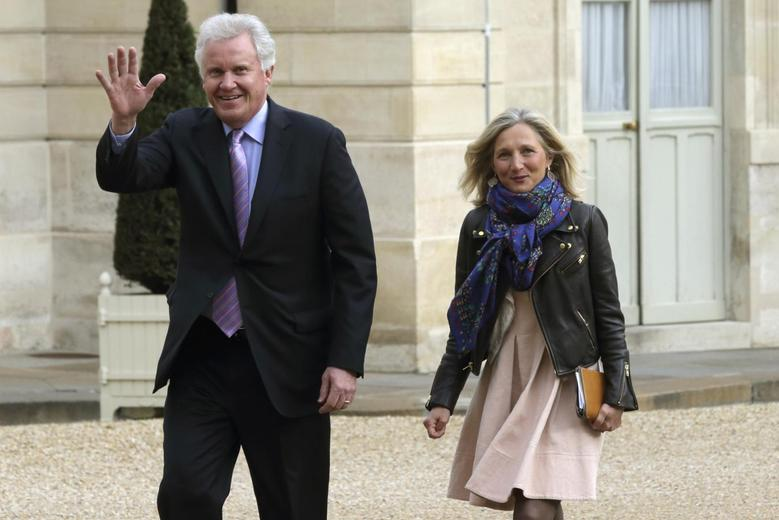 General Electric Chairman and CEO Jeffrey Immelt (L) and Clara Gaymard, the head of GE France, arrive for a meeting with France's President Francois Hollande to discuss the future of French engineering group Alstom at the Elysee Palace in Paris, April 28, 2014. REUTERS/Philippe Wojazer