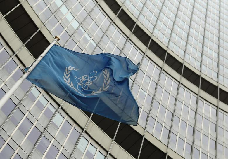 The flag of the International Atomic Energy Agency (IAEA) flies in front of its headquarters in Vienna November 13, 2013. REUTERS/Heinz-Peter Bader