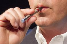 Danny Herko, senior vice president of Research and Development of R.J. Reynolds Tobacco Company, demonstrates the use of a VUSE Digital Vapor Cigarette at a news conference in New York in this file photo taken June 6, 2013. REUTERS/Zoran Milich/Files