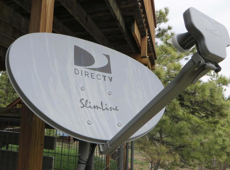 A DirecTV satellite dish is seen on a home in the mountains outside Golden, Colorado May 18, 2014. REUTERS/Rick Wilking