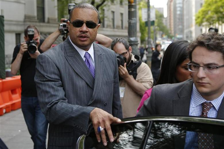 Former New York State Assemblyman Eric Stevenson (L) gets into his car as he leaves the Manhattan Federal Court in New York May 21, 2014. REUTERS/Eduardo Munoz