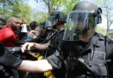 Demonstrators clash with police during a protest at the McDonald's headquarters in Oak Brook, Illinois, May 21, 2014. REUTERS/Jim Young